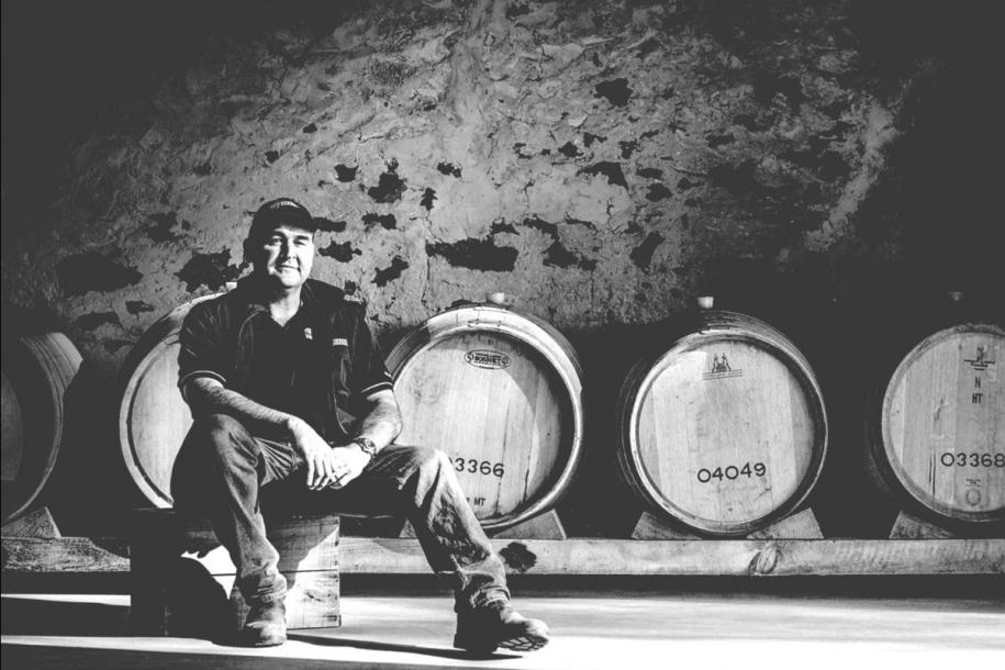 A winemaker in the barrel store